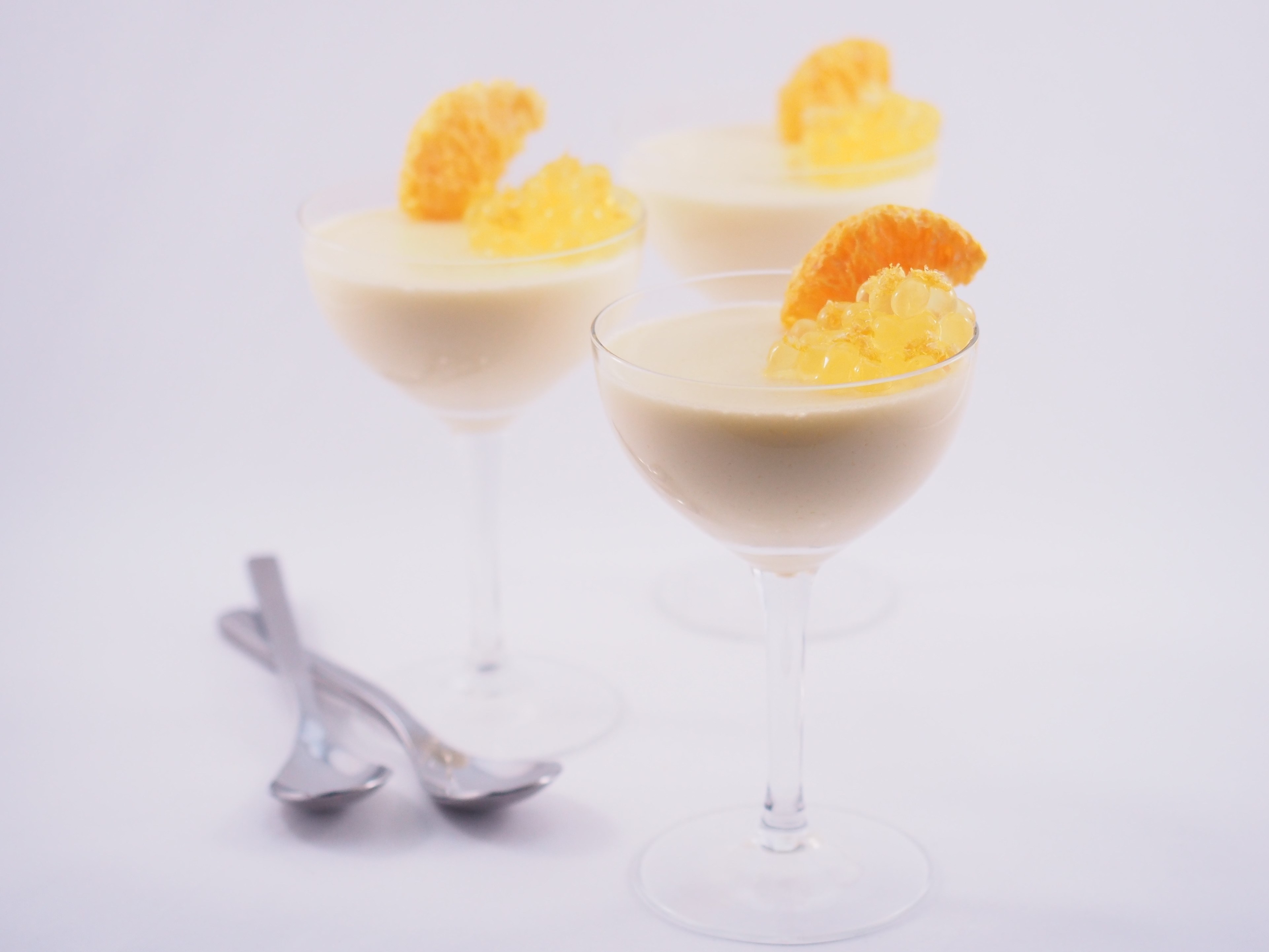 White Chocolate Mousse with Passionfruit Flavour Pearls and Freeze dried Mandarin